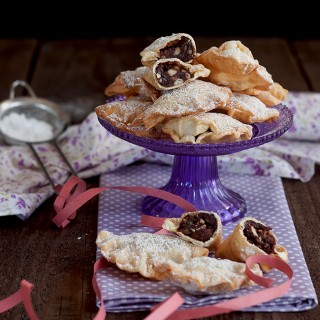 Ravioli dolci cacao e pinoli